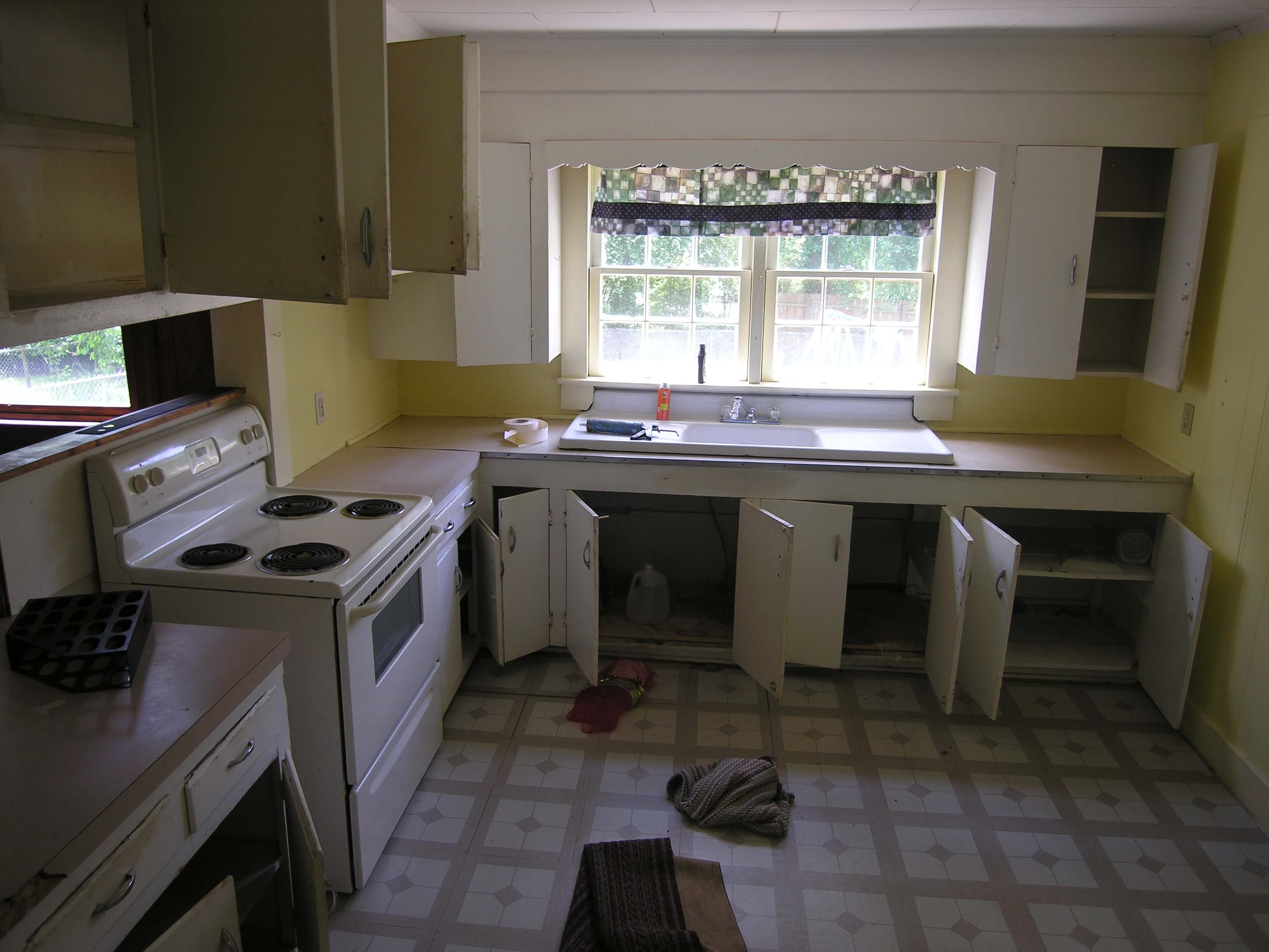 rent house appreciation - kitchen - before