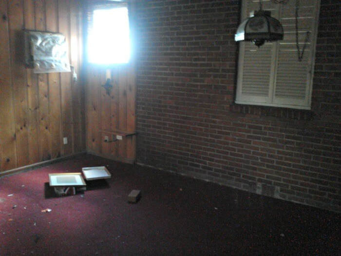 the den of the rental house before - Real Estate Investing While Overseas in Military