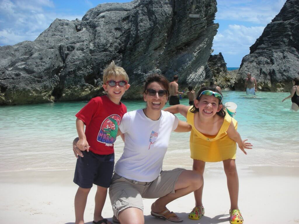 Kat at beach with kids - How a Busy Mom Found Financial Freedom Through Real Estate Investing
