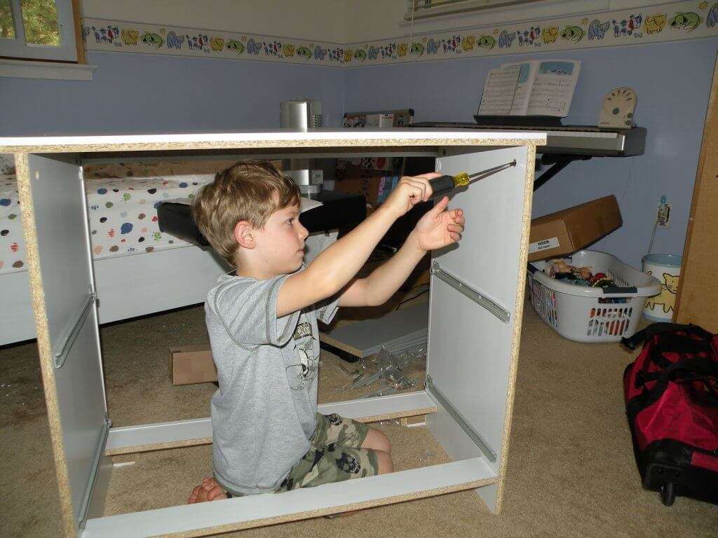 kid helping with repairs - How a Busy Mom Found Financial Freedom Through Real Estate Investing
